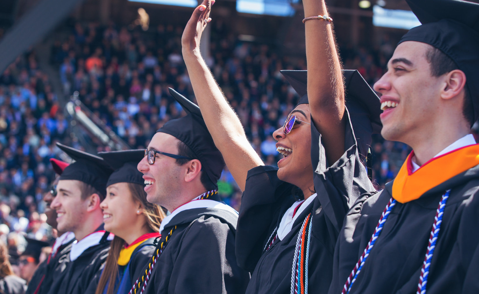 University of Pennsylvania graduates celebrate the accomplishments in graduation attire.