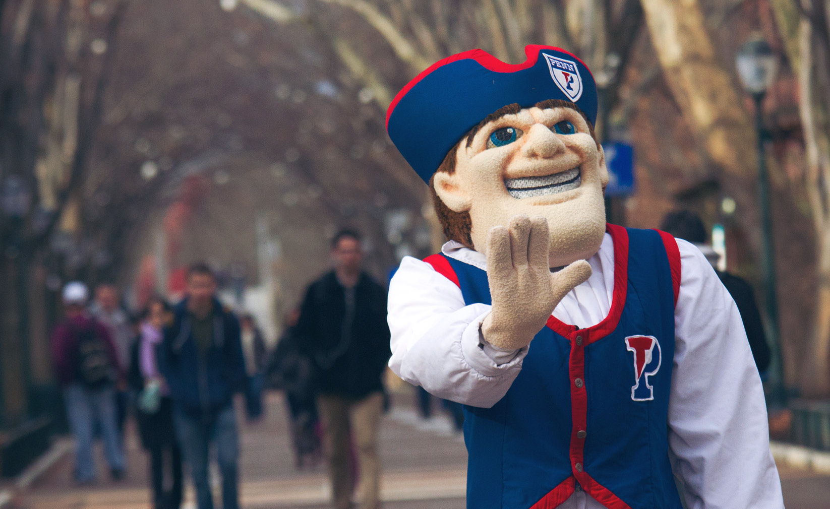 The University of Pennsylvania mascot, the Quaker, strolls through West Philadelphia.