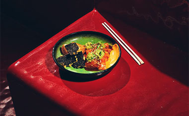 asian food dish with chopsticks