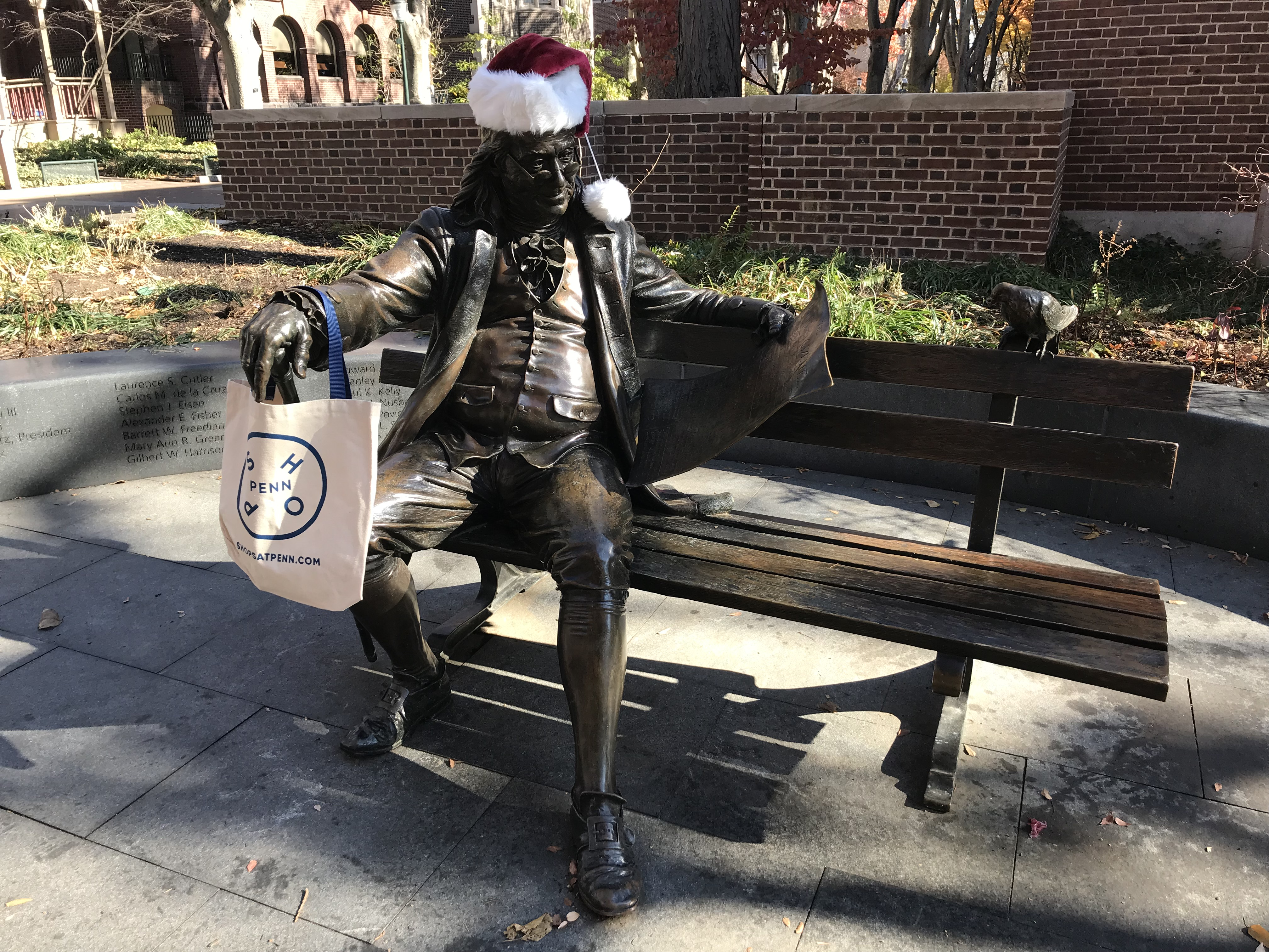 ben franklin statue with winter hat