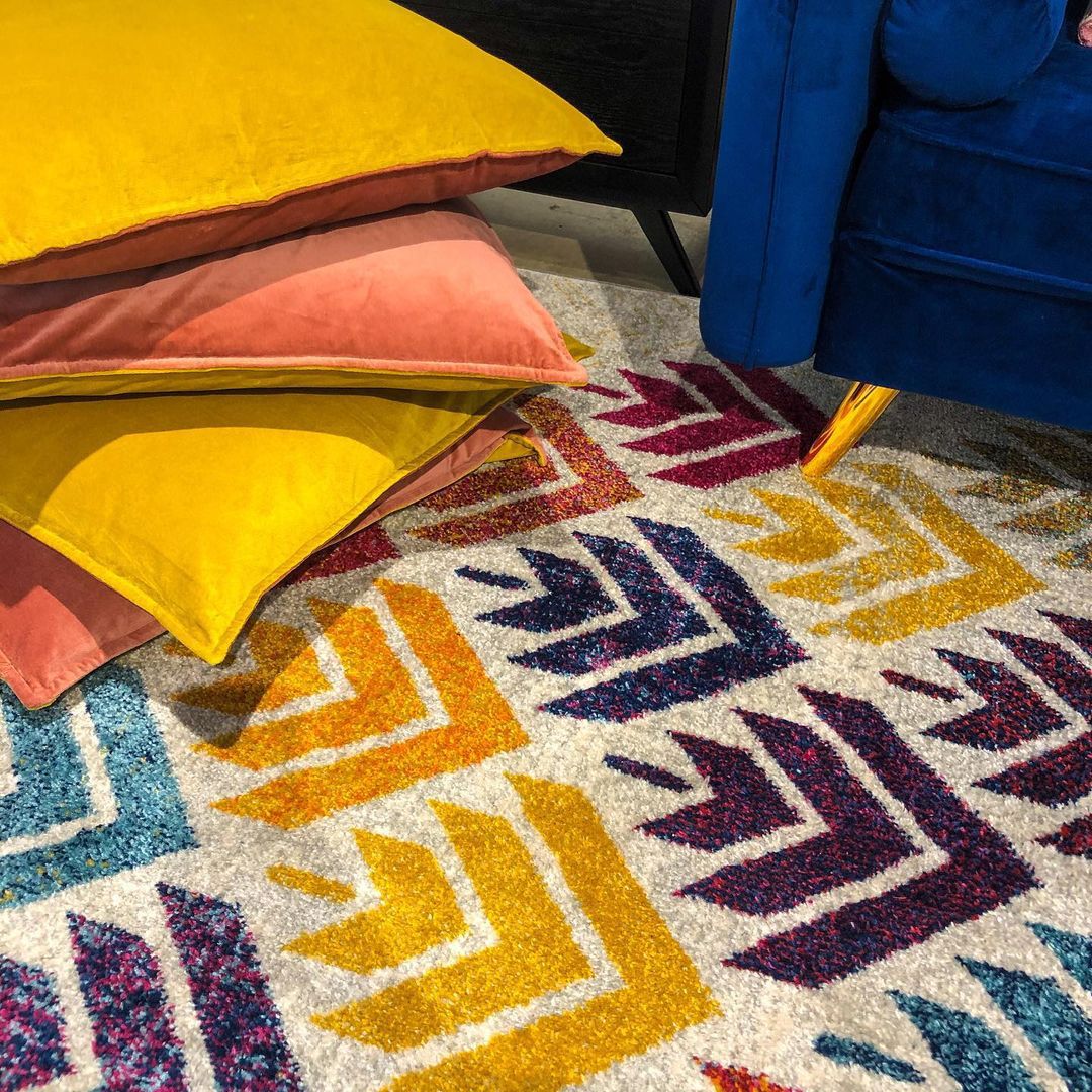 colorful throw pillows and rug
