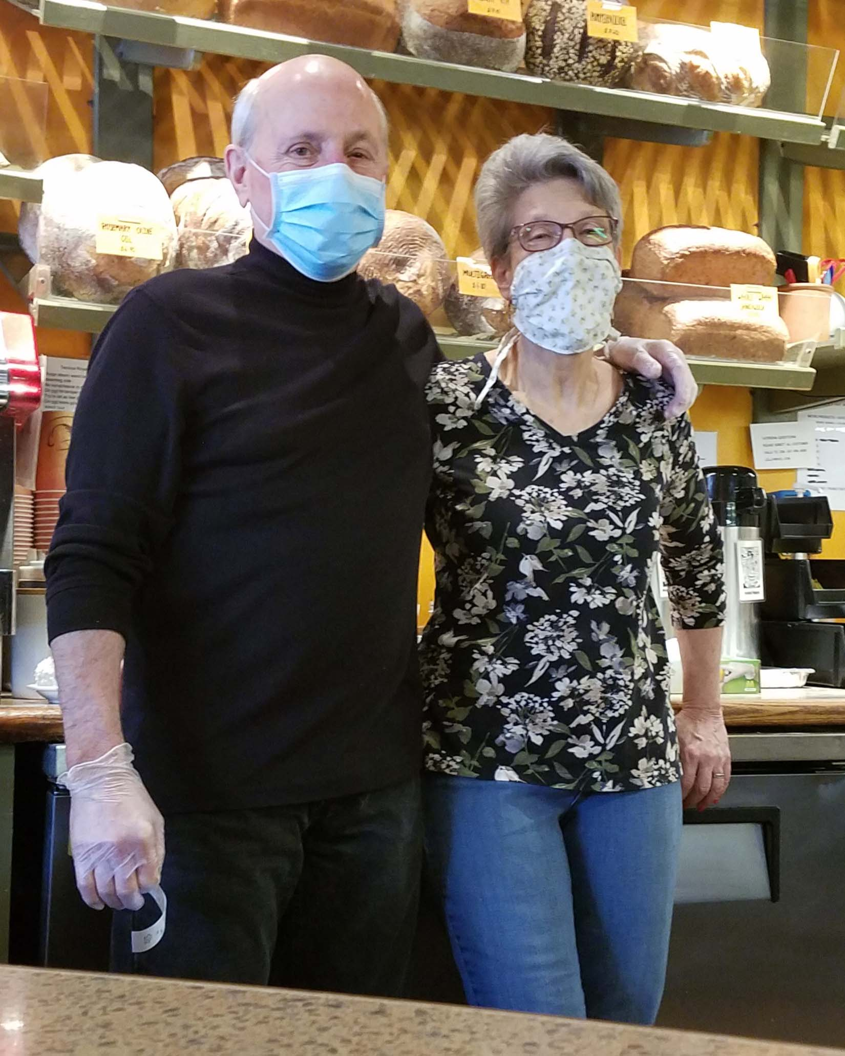 jim lilly and wife in bakery with masks