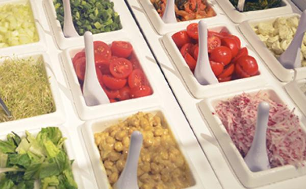 A fresh salad bar with a variety of salad toppings in the Beefsteak restaurant.