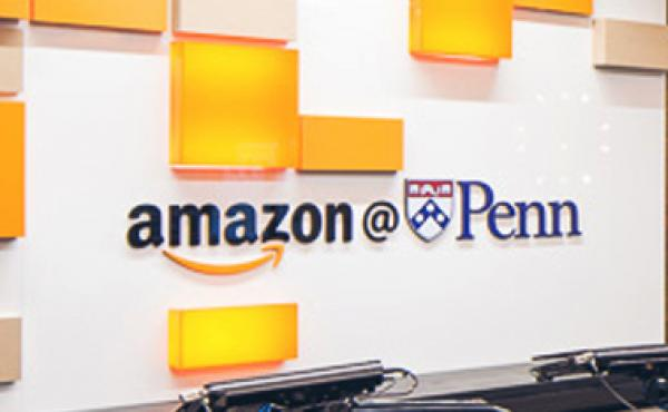 Amazon@Penn logo above a reception desk.