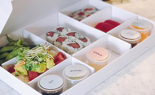 Image of a bento box of DK sushi and sides