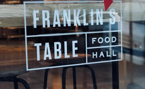 signage in window at Franklins Table