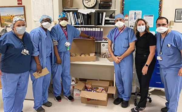 medical professionals posing with donated food