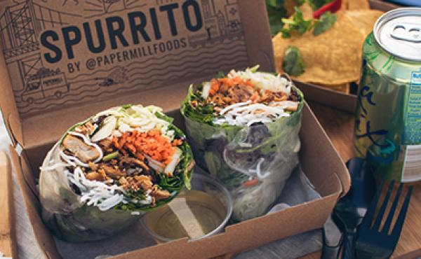 spurrito cut in half in a box
