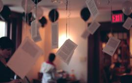 Sheets of paper hanging from the ceiling inside the Kelly Writers House.