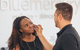 Woman at Bluemercury getting her makeup applied by an employee.