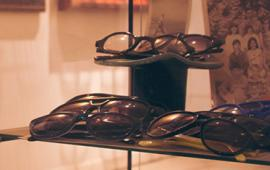 Eyeglasses in a glass display case in the retail store the Modern Eye.
