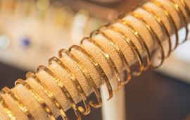 Gold bracelets on display in the Piper Boutique.