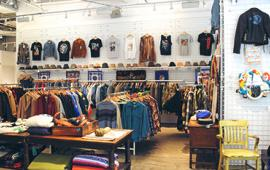 Many clothes on display inside the Raxx Vintage store.