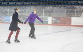 Two individuals enjoy ice skating at Penn Ice Rink